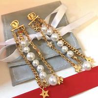 C1591 Koreanische Welle Alle über den Sternen Exquisite Perlenohrringe Frauen Erklärung Multi Layered Long Fransen Brief Blumen Gürtrop