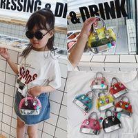 Neueste Kinder Handtaschen Koreanische Mode Baby Mädchen Mini geprägt Geldbörsen Kreuzkörper Nette Gelee Transparente Umhängetaschen Snacks Münzsäcke Geschenke