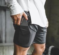 2019 новый мужчина спортивный тренажерный зал сжатие телефона карманный износ под базовый слой короткие штаны спортивные твердые колготки шорты брюки