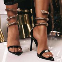 Сиддонс Золотой Змеи Дизайн Женщины моды сандалии Открытый носок лодыжки ремень Sexy Высокие каблуки дамы партии обувь женщина тонкий каблук сандалии