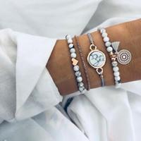10 estilos de los granos de Bohemia pulseras fijado para el amor de las mujeres Mapa tortuga Infinity elefante piña joyería arco del encanto de la manera del brazalete de la luna estrella