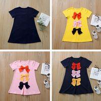 Vestido de niñas de manga corta de verano larga camiseta de color caramelo niño camisetas falda bowknot linda niña princesa vestido niños ropa CZ409