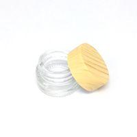 Claro Mini botella de cristal Crema Cera tapa gruesa de aceite envase de plástico de madera del grano tarros de cristal del tanque de almacenamiento cosmética Tarro Contenedores tarro de cristal Caja
