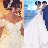 vestidos de novia con cuentas desmontable falda al por mayor-Vestidos de novia árabes de lujo con apliques de falda desmontables Perlas con cuentas Vestido de novia de Dubai Vestidos de novia de talla grande Robe de mariee