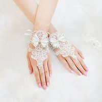 Wholesale glove bow - New 2015 Cheap Long Bridal Gloves Lace Appliques Beads Fingerless Wrist Length With Bow Bridal Gloves Wedding Accessories