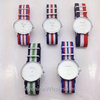 relógios pulseira de tecido mulheres venda por atacado-Top marca de luxo estilo genebra relógios para homens cinta de nylon militar relógio de pulso de quartzo famosa marca das mulheres dos homens tecido cinta esportes reloj