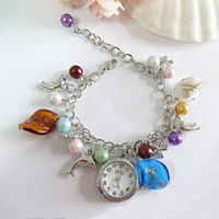 Robe À Bas Prix À Bas Prix Pas Cher-Cheap Multicolor Unique Design Quartz Hour Link Chaîne Fish Plum Blossom Charm Bracelet Dress Pearl Pearl Watch pour Femmes