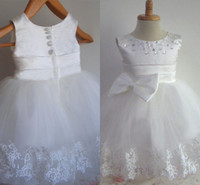 Wholesale Toddler Ivory Dress Tea Length - Cute Little Flowergirl Dresses 2016 from Eiffelbride with Shining Beaded Jewel Neckline and Cute Bow Back Lace Edge Pageant Gowns