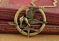 Wholesale Hunger Games Logo - Pendant Necklaces Mockingjay Hungry Game Big Retro Punk Style Hunger Games Necklace Acorn Logo Laugh Birds Parrot Birds Long Necklace