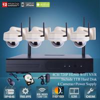 cámaras de seguridad a prueba de vandalismo al aire libre al por mayor-4CH H.264 HDMI WIFI NVR CCTV Kit 720P IR al aire libre Cámara domo a prueba de vandalismo Sistema de vigilancia de seguridad inalámbrico de 1 TB HD