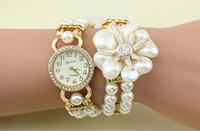 ingrosso le donne di lusso guardano la perla della signora-Fashion Luxury Pearl Flower Watches Pearl Watch Donna Orologi al quarzo Lady Orologi da polso Magnetico con fibbia quadrante rotondo