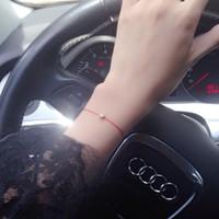 brazaletes de cuerda al por mayor-2016 Preciosa marca de acero de titanio cuerda roja moda brazalete rojo solo circón pulsera de oro rosa natal línea roja mujeres