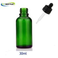 botellas de aceite esencial verde 15ml al por mayor-30 ml botellas de cuentagotas de cristal verde con tapa a prueba de niños y cuentagotas de punta, cosméticos de botella de vidrio de aceite esencial embalaje 5 ml / 10 ml / 15 ml / 20 ml / 50 ml