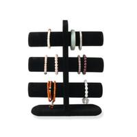 ingrosso puntelli a mano-Espositore del braccialetto del braccialetto dei gioielli del nero tre bracci di mostra dei braccialetti di mostra del tre per il chiosco da tavolino della fiera commerciale che tiene il supporto delle fasce di legno