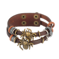 Wholesale Punk Studded Bracelet - 10pcs lot Spider Animal PU Leather Punk Wrapped Expandable Black Religious Snap-Fastener On Leather Studded Bracelets (B108580)