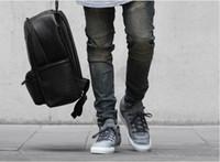 jeans rasgados de tyga al por mayor-pantalones vaqueros rasgados para hombres flaco Distressed slim famoso diseñador de marca biker hip hop swag tyga blanco negro jeans kanye west