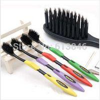 Wholesale Charcoal Material - Wholesale-4pcs lot Free shipping Korea Black Bamboo charcoal toothbrush Nanoscale soft material