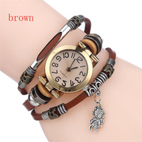 Wholesale Gifts Free Delivery - Free delivery of high quality female cortical retro watches, small fish pendant bracelet watch jewelry Christmas gifts