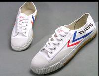 kung fu beyaz siyah toptan satış-Sıcak Feiyue Ultra hafif tuval sneaker Wushu ayakkabı Erkekler ve Kadınlar için, Kung fu için, dövüş sanatları ve rahat spor Klasik siyah Beyaz ayakkabı