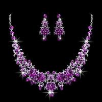 königliche blaue rhinestoneohrringe großhandel-Königsblau / Rot / Lila Sparkly Brautschmuck Sets Ohrringe Halsketten Strass Kristall Perlen Neueste Pageant Girls Prom Zubehör