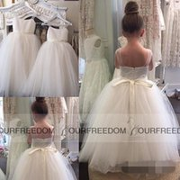 Wholesale hot holy dress - Hot sale Simple Sheer Spaghetti Straps Tulle Ball Gown Backless Flower Girl Dress For Wedding Holy the First Communion Gown With Sash