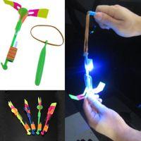 Wholesale Boomerang Free - 24PCS Lot Children Fun LED Light Flying Sling Helicopter Rocket Arrow Toy Frisbee Flyer Boomerang Toy Free Shipping