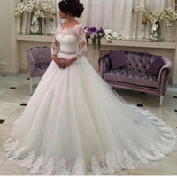 Wholesale Wedding Gown Lace Trims - 2015 Romantic Ball Gown Wedding Dresses Ivory 3 4 Long Sleeves Scoop Neckline Beaded Belt Lace Trimmed Tulle Chapel Train Bridal Gowns 2016