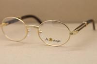 runde schwarze rahmen für gläser großhandel-High-End-Auge Runde Brille Ovale Brille Hot Metal Unisex 2822546 Schwarzes Büffelhorn Brille Männer Brillen Frames Größe: 53-22-140 MM
