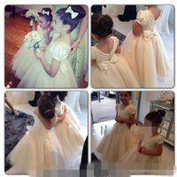 Wholesale Wedding Puff Sleeves Dress - 2015 Cheap Custom made little wedding flower girls' dresses puff A line tulles short cap sleeves with crew neck floor length party gowns