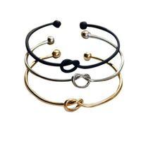 pulsera de nudo negro al por mayor-Love Knot Bangle Bracelet Brazaletes de brazalete de nudo de corazón simple para mujeres niñas oro plata negro Charm Bangles