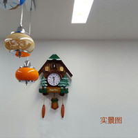 black cuckoo clock - European style wall clock cuckoo time swing bracket clock creative modern cuckoo bird out of the window of the sitting room
