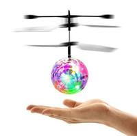 Wholesale Led Lighting For Helicopter - Flying RC Ball Aircraft Helicopter Led Flashing Light Up Toy Induction Toy Electric Toy Drone For Kids Children c044