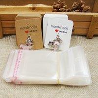 ingrosso fai la borsa diy-Il nuovo DIY fatto a mano con amore Kraft / pendente bianco / etichetta su ordinazione incantano il sacchetto del opp della carta 100pcs + 100pcs di imballaggio affascinante del pendente