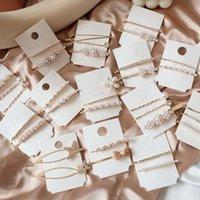 imitacion corea strass al por mayor-1 juego clips elegante imitación de la perla del Bowknot del pelo de la flor de los Rhinestones de la estrella de las horquillas para Corea Mujeres Accesorios para el cabello