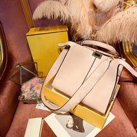 flache taschen großhandel-Berühmte marke designer luxus handtasche licht mittelgroße innentasche flach pailletten brief rindsleder echtes leder breite handtasche