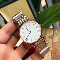 reloj de lujo hombres delgados al por mayor-Modelos de explosión de lujo marca ultrafina de moda tendencia comercial, hombres y mujeres, aleación redonda impermeable reloj de cuarzo correa de acero inoxidable