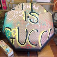 impresión de recubrimiento uv al por mayor-Paraguas plegable de personalidad con protección UV Carta de impresión Graffiti Sombrilla para mujer Chica Moda Negro Revestimiento Sombrilla de playa