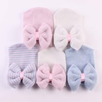 Wholesale hat band baby resale online - 0 Months Newborn Baby Hats Toddlers Knit Bowknot Caps Soft Cotton Beanie With Bow Kids Striped Hat hair bands styles GGA2657