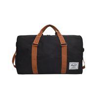 качественная сумочка для путешествий оптовых-Men women Black Travel Bag high quality canvas Shoulder Bag Women Handbag Ladies Weekend Portable Duffel Waterproof Wash