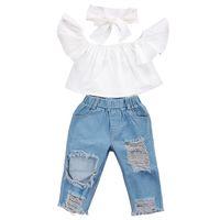 kot pantolon kız pantolon toptan satış-Yaz bebek kız çocuk giysileri Set Uçan kollu Beyaz üst + Yırtık Kot Denim pantolon + yay Bandı 3 adet setleri Çocuklar Giysi Tasarımcısı Kızlar JY352