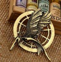 juegos de hambre mockingjay broche pin al por mayor-Figuras juegos del hambre auténtica joyería Prop imitación de Katniss Pin Pin Película el Sinsajo Birds Aleaciones Broche libre de DHL