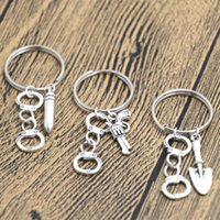 Wholesale keyring guns resale online - New Style Hot Ancient Silver Partner In Crime Handcuff Gun Bullet Charm Pendant Keyring Keychain Men Women Jewelry Best Friend Holiday Gift