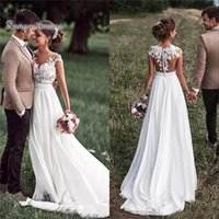 Wholesale cheap beach wedding dresses online - 2019 Cheap Boho Beach A line Wedding Dresses With Cap Sleeves and Appliques Buttons Back Bridal Gowns
