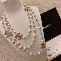 collar argentino al por mayor-Diseñador de la marca de lujo de diamantes collar largo collar de perlas naturales para mujer collar de cristal importado 18 K broche de oro joyería