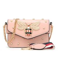 bolso de color perla al por mayor-Fábrica al por mayor marca mujeres bolso nueva perla cadena bolsa abejas pequeñas mujeres de bloqueo bolsa de hombro personalidad tachonada Messenger bag