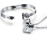 bracelets à clés à clé achat en gros de-Couple titane Bracelet de serrure Bracelet Titanium Bracelet Collier Ensemble de bijoux en acier au titane Valentine Day