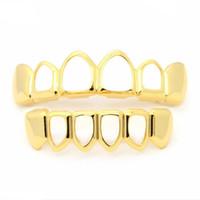 soportes de oro al por mayor-Gold Braces Teeth Grills Dientes de oro con brackets populares Black Hip-Hop Hollow Venta caliente en Europa y América