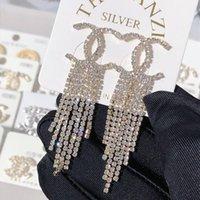 çiçekler elmas takılar inciler toptan satış-Son moda kadınlar için üst tasarımcı yılan elmas çiviler rhinestone yılan hayvan küpe kolye bayan accesscires inci çiçek küpe