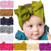 bebek kızları için baş bantları toptan satış-Bebek Düğüm Bandı Kızlar büyük yay bantlar Elastik Ilmek hairbands Türban Katı Şapkalar Kafa Wrap Saç Bandı Aksesuarları 12 stilleri GGA2009