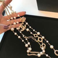 ingrosso donna della collana dell'oro 18k-Donne Moda 18K Collana d'oro Collana di perle naturali Maglione Multistrato Collana di diamanti Importa spilla di cristallo Gioielli da sposa